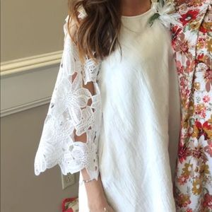 White dress with lace bell sleeves. Size small